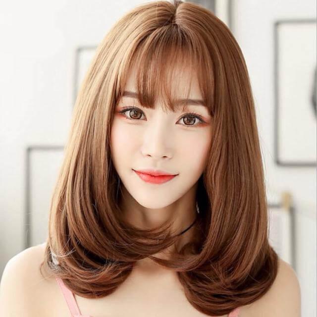 Tóc uốn phồng chữ C giúp mái tóc bồng bềnh hơn